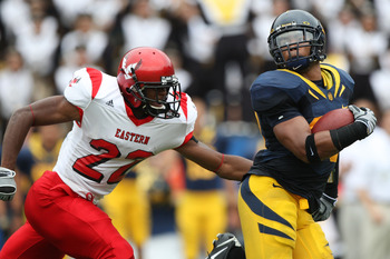 BERKELEY, CA - SEPTEMBER 12: Mychal Kendricks #30 of the California Golden Bears returns a fumble for 45 yards against Taiwan Jones #22 of the Eastern Washington Eagles at Memorial Stadium on September 12, 2009 in Berkeley, California. (Photo by Jed Jacob