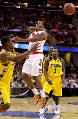 CLEVELAND, OH - MARCH 20: Scoop Jardine #11 of the Syracuse Orange makes a no look pass as Jimmy Butler #33 and Darius Johnson-Odom #1 of the Marquette Golden Eagles look on during the third of the 2011 NCAA men's basketball tournament at Quicken Loans Ar