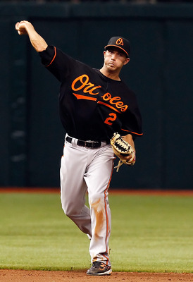 ST. PETERSBURG, FL - APRIL 01:  Shortstop J.J. Hardy #2 of the Baltimore Orioles throws over to first for the final out against the Tampa Bay Rays during the Opening Day game at Tropicana Field on April 1, 2011 in St. Petersburg, Florida.  (Photo by J. Me