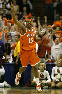 ALBANY, NY - MARCH 30:  Carmelo Anthony of the Syracuse Orangemen celebrates his team's 63-47 win over the Oklahoma Sooners during the East Regionals of the NCAA Championship on March 30, 2003 at the Pepsi Arena in Albany, New York. (Photo by Al Bello/Get