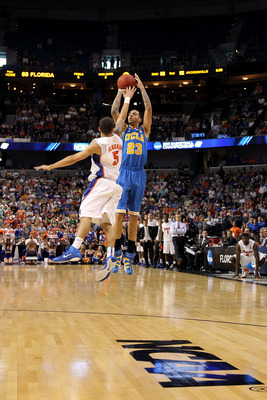 TAMPA, FL - MARCH 19:  Tyler Honeycutt #23 of the UCLA Bruins attempts a shot against Scottie Wilbekin #5 of the Florida Gators during the third round of the 2011 NCAA men's basketball tournament at St. Pete Times Forum on March 19, 2011 in Tampa, Florida