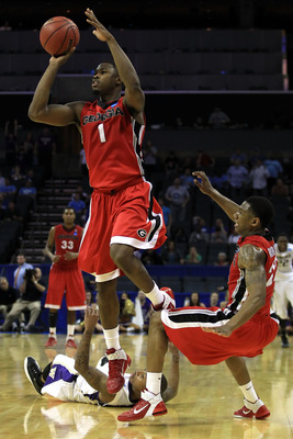 CHARLOTTE, NC - MARCH 18:  Travis Leslie #1 of the Georgia Bulldogs misses a last second three-pointer that would have tied the game against the Washington Huskies during the second round of the 2011 NCAA men's basketball tournament at Time Warner Cable A