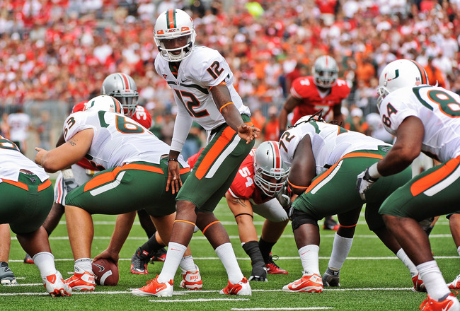 COLUMBUS, OH - SEPTEMBER 11:  Quarterback Jacory Harris #12 of the Miami Hurricanes calls the play at the line against the Ohio State Buckeyes at Ohio Stadium on September 11, 2010 in Columbus, Ohio.  (Photo by Jamie Sabau/Getty Images)