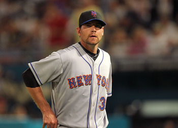 MIAMI GARDENS, FL - APRIL 01:  Mike Pelfrey #34 of the New York Mets walks off the mound during opening day against the Florida Marlins at Sun Life Stadium on April 1, 2011 in Miami Gardens, Florida.  (Photo by Mike Ehrmann/Getty Images)