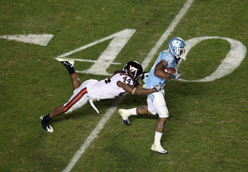 CHAPEL HILL, NC - NOVEMBER 13:  Lyndell Gibson #44 of the Virginia Tech Hokies tackles Shaun Draughn #20 of the North Carolina Tar Heels during their game at Kenan Stadium on November 13, 2010 in Chapel Hill, North Carolina.  (Photo by Streeter Lecka/Gett