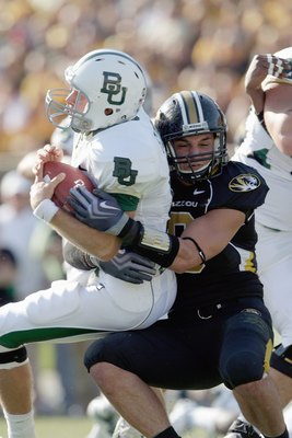 COLUMBIA, MO - NOVEMBER 7:  Quarterback Nick Florence #11 of the Baylor Bears is sacked during the game against the Missouri Tigers at Faurot Field at Memorial Stadium on November 7, 2009 in Columbia, Missouri. (Photo by Jamie Squire/Getty Images)
