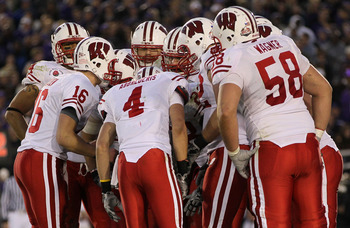 PASADENA, CA - JANUARY 01:  The Wisconsin Badgers huddle together during their game against the TCU Horned Frogs in the 97th Rose Bowl game on January 1, 2011 in Pasadena, California.  (Photo by Jeff Gross/Getty Images)