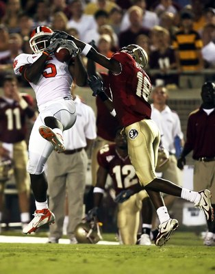 TALLAHASSEE, FL - SEPTEMBER 16:  Cornerback J.R. Bryant #18 of the Florida State Seminoles can't stop a reception by wide receiver Rendrick Taylor #5 of the Clemson Tigers at Doak Campbell Stadium on September 16, 2006 in Tallahassee, Florida.  (Photo by
