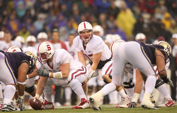 SEATTLE - OCTOBER 30:  Quarterback Andrew Luck #12 of the Stanford Cardinal looks over the defense during the game against the Washington Huskies on October 30, 2010 at Husky Stadium in Seattle, Washington. Stanford won 41-0. (Photo by Otto Greule Jr/Gett
