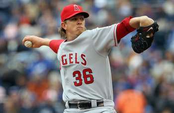 KANSAS CITY, MO - MARCH 31:  Starting pitcher Jered Weaver #36 of the Los Angeles Angels of Anaheim delivers his first pitch during the 1st inning of the opening day game against the Kansas City Royals at Kauffman Stadium on March 31, 2011 in Kansas City,