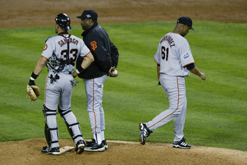 ANAHEIM, CA - OCTOBER 27:  Livan Hernandez #61 of the San Francisco Giants walks off the mound after being pulled as manager Dusty Baker and Benito Santiago #33 wait for new pitcher Chad Zerbe in the third inning of game seven of the World Series against