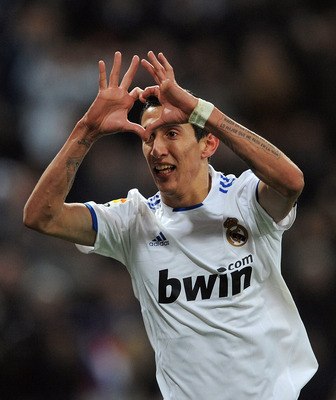 MADRID, SPAIN - MARCH 03:  Angel Di Maria of Real Madrid of Real Madrid celebrates after scoring Real''s second goal during the La Liga match bewteen Real Madrid and Malaga at Estadio Santiago Bernabeu on March 3, 2011 in Madrid, Spain.  (Photo by Denis D