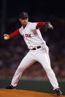 BOSTON - OCTOBER 13:  Starter Tim Wakefield #49 of the Boston Red Sox pitches during game four of the American League Championship Series against the New York Yankees on October 13, 2003 at Fenway Park in Boston, Massachusettes. The Red Sox won 3-2. (Phot