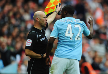 LONDON, ENGLAND - APRIL 16:  Yaya Toure of Manchester City argues with the assistant referee during the FA Cup sponsored by E.ON semi final match between Manchester City and Manchester United at Wembley Stadium on April 16, 2011 in London, England.  (Phot