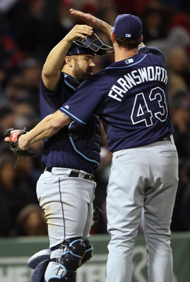 BOSTON, MA - APRIL 12:  Kelly Shoppach #10 of the Tampa Bay Rays celebrates the win the teammate Kyle Farnsworth #43 on April 12, 2011 at Fenway Park in Boston, Massachusetts. The Tampa Bay Rays defeated the Boston Red Sox 3-2.  (Photo by Elsa/Getty Image