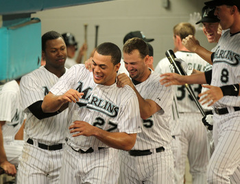 MIAMI GARDENS, FL - APRIL 21:  Mike Stanton #27 of the Florida Marlins is congratulated by Hanley Ramirez #2 and Gaby Sanchez #15 after hitting  his first home run of the year during a game against the Pittsburgh Pirates at Sun Life Stadium on April 21, 2