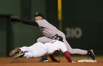 BOSTON - OCTOBER 17:  Dave Roberts #31 of the Boston Red Sox steals second base while shortstop Derek Jeter #2 of the New York Yankees waits for the throw in the ninth inning against the New York Yankees during game four of the American League Championshi