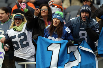 CHICAGO, IL - JANUARY 16:  Seattle Seahawks fans cheer before the Seahawks take on the Chicago Bears in the 2011 NFC divisional playoff game at Soldier Field on January 16, 2011 in Chicago, Illinois.  (Photo by Doug Pensinger/Getty Images)