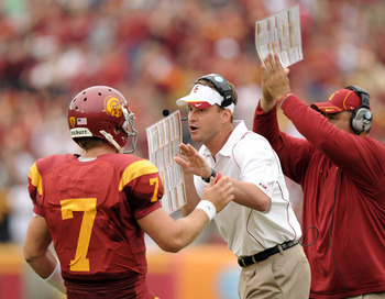 LOS ANGELES, CA - OCTOBER 16: Head Coach Lane Kiffin and Matt Barkley #7 of the USC Trojans react to a 3rd and 1 conversion against the California Golden Bears during the second quarter at Los Angeles Memorial Coliseum on October 16, 2010 in Los Angeles,