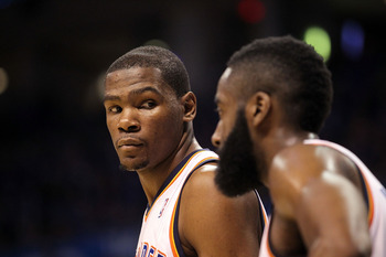 OKLAHOMA CITY, OK - MAY 03:  Forward Kevin Durant #35 of the Oklahoma City Thunder looks at James Harden #13 during play against the Memphis Grizzlies in Game Two of the Western Conference Semifinals in the 2011 NBA Playoffs on May 3, 2011 at Oklahoma Cit