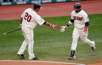 CLEVELAND - APRIL 30:  Carlos Santana #41 of the Cleveland Indians is congratulated by teammate Orlando Cabrera #20 after hitting a home run against the Detroit Tigers during the game on April 30, 2011 at Progressive Field in Cleveland, Ohio.  (Photo by J