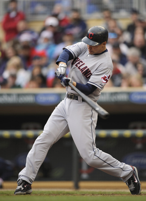 MINNEAPOLIS, MN - APRIL 23: Grady Sizemore #24 of the Cleveland Indians hits a two-run home run against the Minnesota Twins during the eighth inning of their game on April 23, 2011 at Target Field in Minneapolis, Minnesota. (Photo by Hannah Foslien/Getty