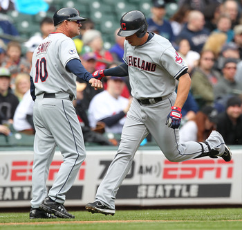 SEATTLE - APRIL 10:  Asdrubal Cabrera #13 of the Cleveland Indians is congratulated by third base coach Steve Smith #10 after hitting a solo home run in the first inning against the Seattle Mariners at Safeco Field on April 10, 2011 in Seattle, Washington