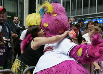 NEW YORK - JULY 15: Slider the mascot for the Cleveland Indians and fan during the MLB All-Star Game Red Carpet Parade on July 15, 2008 in New York City.  (Photo by Mike Stobe/Getty Images)