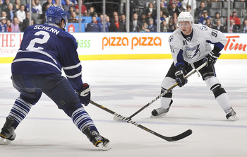 TORONTO, CANADA - NOVEMBER 30:  Luke Schenn #2 of the Toronto Maple Leafs defends against Steven Stamkos #91of the Tampa Bay Lightning during game action November 30, 2010 at the Air Canada Centre in Toronto, Ontario, Canada. (Photo by Abelimages/Getty Im