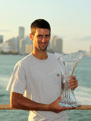KEY BISCAYNE, FL - APRIL 03:  Novak Djokovic of Serbia poses with the trophy at the Rusty Pelican Restraunt after winning the men's singles title from the Sony Ericsson Open at Crandon Park Tennis Center on April 3, 2011 in Key Biscayne, Florida.  (Photo