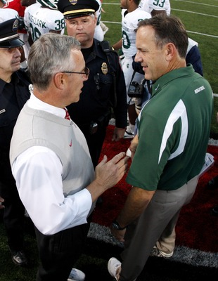 COLUMBUS, OH - OCTOBER 20: Jim Tressel head coach of the Ohio State Buckeyes shakes hands after 24-17 victory with Mark Dantonio head coach of the Michigan State Spartans at Ohio Stadium October 20, 2007 in Columbus, Ohio. (Photo By Gregory Shamus/Getty I