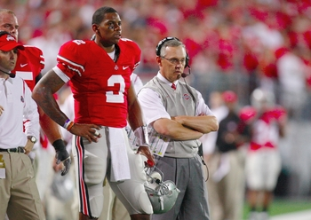 COLUMBUS, OH - SEPTEMBER 12:  Terrelle Pryor #2 and head coach Jim Tressel of the Ohio State Buckeyes look on from the sidelines during their game against the USC Trojans at Ohio Stadium on September 12, 2009 in Columbus, Ohio. (Photo by Gregory Shamus/Ge