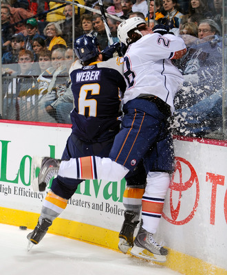 NASHVILLE, TN - MARCH 22:  Shea Weber #6 of the Nashville Predators checks Ryan Jones #28 of the Edmonton Oilers on March 22, 2011 at the Bridgestone Arena in Nashville, Tennessee.  (Photo by Frederick Breedon/Getty Images)