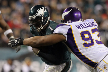 PHILADELPHIA, PA - DECEMBER 28:  Michael Vick #7 of the Philadelphia Eagles in action against Kevin Williams #93 of the Minnesota Vikings at Lincoln Financial Field on December 26, 2010 in Philadelphia, Pennsylvania.  (Photo by Jim McIsaac/Getty Images)