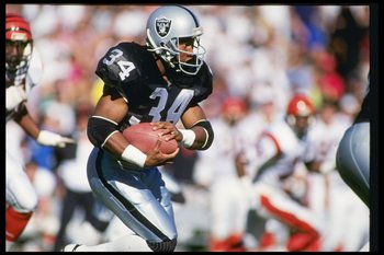 13 Jan 1991: Running back Bo Jackson of the Los Angeles Raiders runs down the field during a playoff game against the Cincinnati Bengals at the Los Angeles Coliseum in Los Angeles, California. The Raiders won the game 20-10.