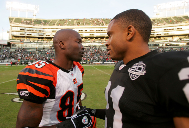 OAKLAND, CA - NOVEMBER 22:  Chad Ochocinco #85 of the Cincinnati Bengals is consoled by Nnamdi Asomugha #21 of the Oakland Raiders after the Raiders beat the Bengals at Oakland-Alameda County Coliseum on November 22, 2009 in Oakland, California.  (Photo b