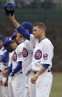 CHICAGO, IL - APRIL 01:  Kerry Wood #34 of the Chicago Cubs tips his hat to fans during player introductions prior to playing the Pittsburgh Pirates on opening day at Wrigley Field on April 1, 2011 in Chicago, Illinois. Pittsburgh won the game 6-3. (Photo