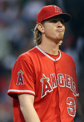 BOSTON, MA - MAY 02:  Jered Weaver #36 of the Los Angeles Angels heads back to the dugout after the first inning against the Boston Red Sox on May 2, 2011 at Fenway Park in Boston, Massachusetts.  (Photo by Elsa/Getty Images)