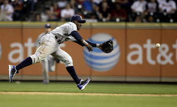 HOUSTON - APRIL 15:  Second baseman Orlando Hudson #1 of the San Diego Padres can't reach this ground ball hit by Carlos Lee #45 of the Houston Astros in the ninth inning at Minute Maid Park on April 15, 2011 in Houston, Texas.  (Photo by Bob Levey/Getty