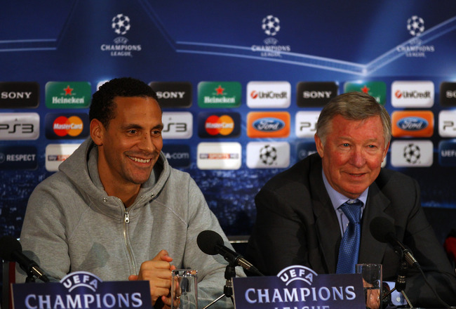 MANCHESTER, ENGLAND - APRIL 11:  Sir Alex Ferguson the manager of Manchester United and Rio Ferdinand face the media during a press conference ahead of their UEFA Champions League quarter final second leg match against Chelsea at the Old Trafford on April