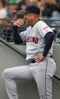 SEATTLE - APRIL 10:  Manager Manny Acta #11 of the Cleveland Indians looks on against the Seattle Mariners at Safeco Field on April 10, 2011 in Seattle, Washington. The Indians defeated the Mariners 6-4. (Photo by Otto Greule Jr/Getty Images)