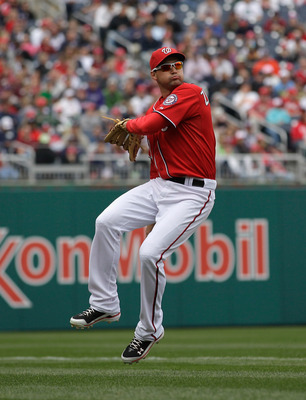 WASHINGTON, DC - APRIL 03:  Third baseman Ryan Zimmerman #11 of the Washington Nationals makes a play against the Atlanta Braves at Nationals Park on April 3, 2011 in Washington, DC.  (Photo by Rob Carr/Getty Images)