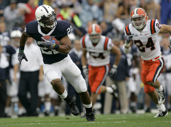 STATE COLLEGE, PA - SEPTEMBER 12:  Running back Evan Royster #22 of the Penn State Nittany Lions runs for a touchdown followed by Mikhail Marinovich (54) and Max Suter #24 of the Syracuse Orangemen during the first half at Beaver Stadium  September 12, 20