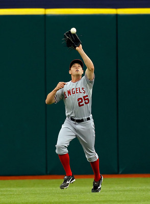 ST. PETERSBURG, FL - MAY 01:  Outfielder Peter Bourjos #25 of the Los Angeles Angels of Anaheim catches a fly ball against the Tampa Bay Rays during the game at Tropicana Field on May 1, 2011 in St. Petersburg, Florida.  (Photo by J. Meric/Getty Images)