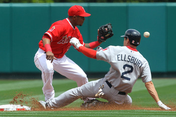 ANAHEIM, CA - APRIL 24:  Jacoby Ellsbury #2 of the Boston Red Sox slides into second with a leadoff double as shortstop Erick Aybar #2 of the Los Angeles Angels of Anaheim takes the throw in the first inning on April 24, 2011 at Angel Stadium in Anaheim,