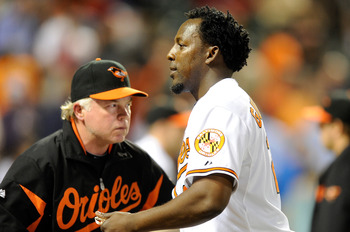 BALTIMORE, MD - APRIL 27:  Vladimir Guerrero #27 of the Baltimore Orioles is congratulated by manager Buck Showalter #26 after a 5-4 victory against the Boston Red Sox at Oriole Park at Camden Yards on April 27, 2011 in Baltimore, Maryland. (Photo by Greg