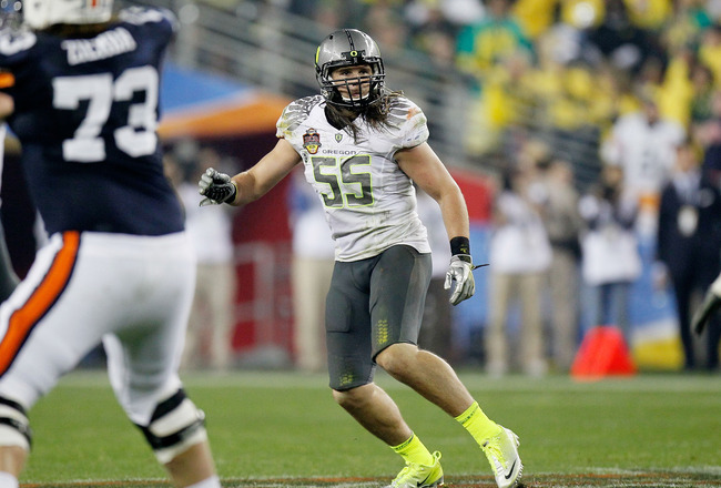 GLENDALE, AZ - JANUARY 10:  Casey Matthews #55 of the Oregon Ducks watches the play against the Auburn Tigers during the Tostitos BCS National Championship Game at University of Phoenix Stadium on January 10, 2011 in Glendale, Arizona.  (Photo by Kevin C.