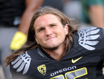 EUGENE, OR - SEPTEMBER 04:  Linebacker Casey Matthews #55 of the Oregon Ducks watches the action from the sidelines in the third quarter of the game against the New Mexico Lobos at Autzen Stadium on September 4, 2010 in Eugene, Oregon. Oregon won the game