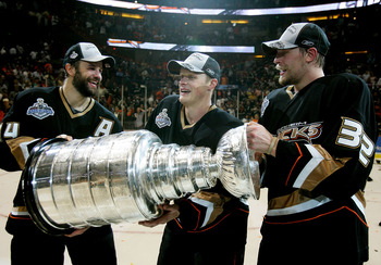 ANAHEIM, CA - JUNE 06:  (L-R) Rob Niedermayer #44, Samuel Pahlsson #26 and Travis Moen #32 of the Anaheim Ducks celebrate winning the Stanley Cup after defeating the Ottawa Senators in Game Five of the 2007 Stanley Cup finals on June 6, 2007 at Honda Cent