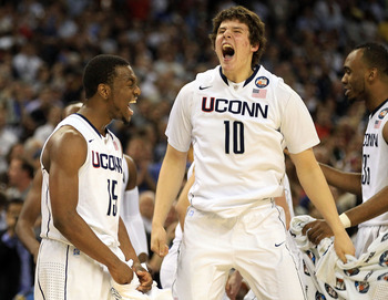 HOUSTON, TX - APRIL 04:  Kemba Walker #15 and Tyler Olander #10 of the Connecticut Huskies react after defeating the Butler Bulldogs to win the National Championship Game of the 2011 NCAA Division I Men's Basketball Tournament by a score of 53-41 at Relia